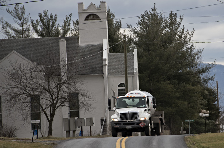 A gas delivery truck rounds a turn on Reliance Road just past Reliance United Methodist Church on Tuesday. Rich Cooley/Daily