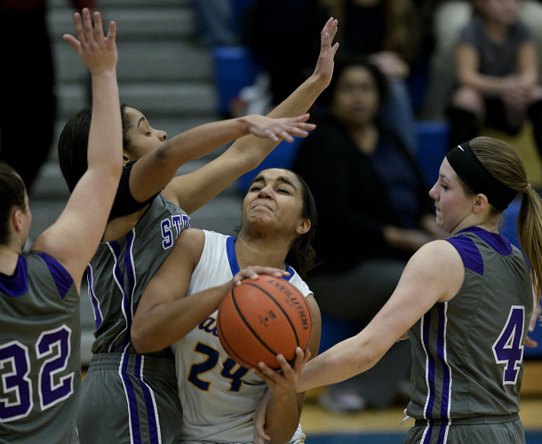 Central's Ayanna Strother penetrates inside between Strasburg's Christyan Reid, left, and Madison Smallwood, right, during second quarter action Thursday night in Woodstock. Reid was called for a foul on the play.  Rich Cooley/Daily