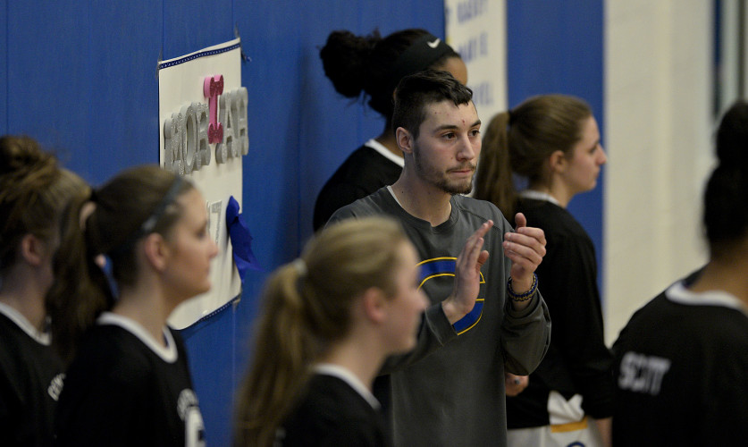 Central High School girls basketball manager John Albright cheers his team on as they go through warm up drills before their game against Strasburg on February 2. Rich Cooley/Daily