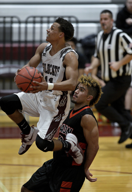 Warren's Cam Ford glides by George Mason's Dustin Green on a fast break during a game on Feb. 6 in Fornt Royal.  Ford averaged 20 points and an area-best 2.8 steals per game for Warren County this season. Rich Cooley/Daily