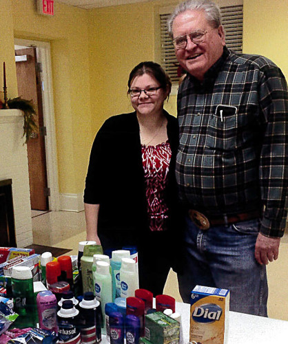 Powhatan Ruritan Club President Rachel Shoemaker and Citizen and Patriotism Chairman Richard Lawson look over the hygiene supplies donated by club members that will be distributed to the Veteran's Medical Center in Martinsburg, West Virginia. The committee also donated 50 winter coats to the Salvation Army. Courtesy photo