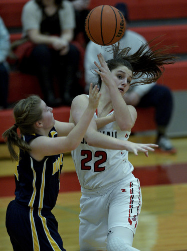 Highland County's Morgan Adams battles with Stonewall's Sara Streett for the ball during second quarter action Friday night in Quicksburg.  Rich Cooley/Daily
