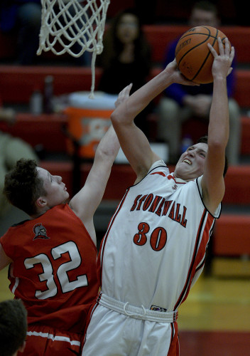 Stonewall's Nick Dotson is fouled while he goes up under the basket against Riverheads' Braeson Fulton during third quarter action of the Conference 44 semifinals held Tuesday night in Quicksburg. The Generals lost 59-41 ending their season. Rich Cooley/Daily