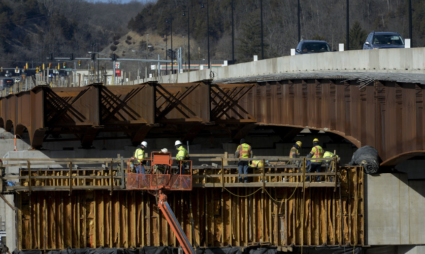 Construction crews pour concrete to form the pier caps along the south side of the South Fork River bridge on Wednesday. The $48.4 million project is scheduled to be completed by the end of the year.   Rich Cooley/Daily