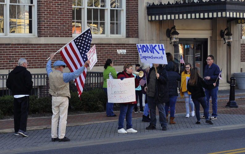 Protesters gathered outside the George Washington Hotel in Winchester on Friday, near U.S. Rep. Barbara Comstock's office, to demand she appear before her constituents at a town hall event. Jake Zuckerman/Daily