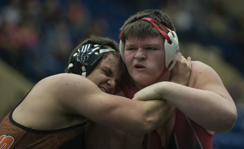 Stonewall's Dakota Bush, right,  is tangled with Rural Retreat's Ben Sowers in the Group 1A 285 pound state title in Salem on Saturday.  Bush fell in the state championship match. Rich Cooley/Daily