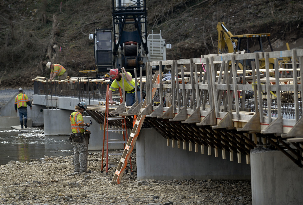 Construction workers with Orders Construction Company continue construction on the $2.1 million Artz Road bridge located north of Woodstock. The bridge,  which will be built  downstream from the existing low water bridge, is being built higher to reduce the times of high-water events. The bridge is scheduled to be completed in spring 2018. Rich Cooley//Daily