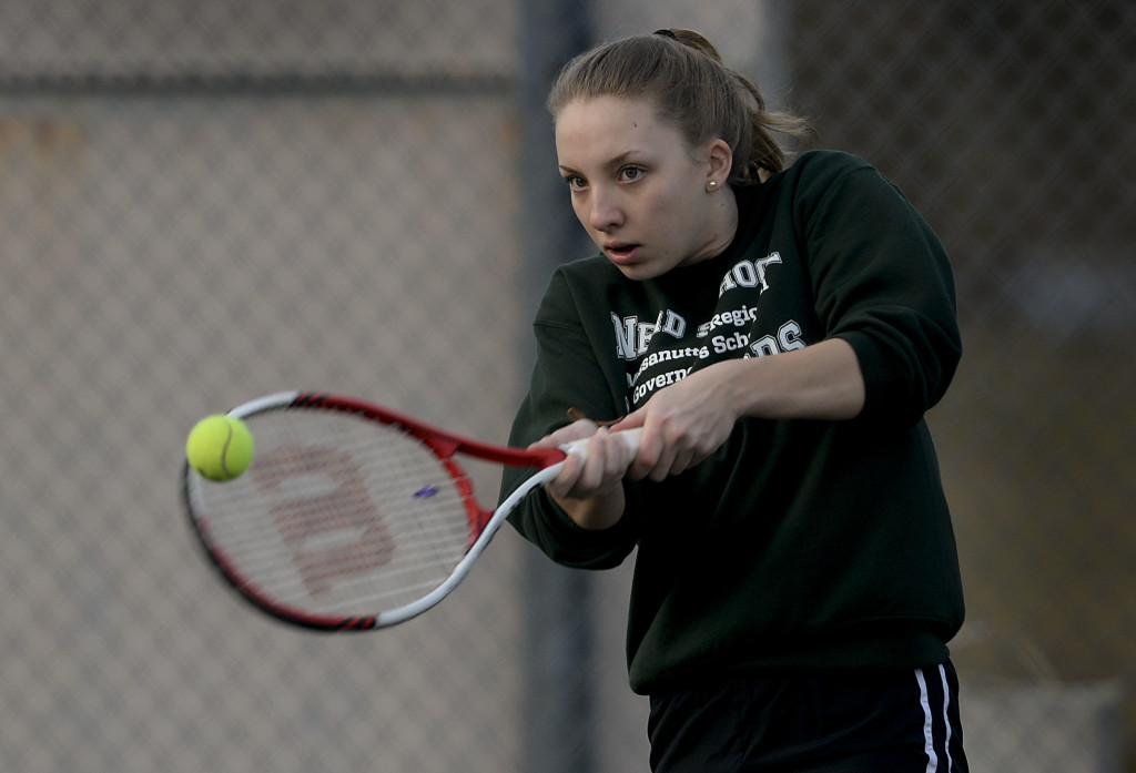 Stonewall's Emily Ball returns  the ball with a backhand during a recent practice at New Market's town park. The senior is starting her second season with the Generals and will be playing at one of the top two spots on the team this year.  Rich Cooley/Daily