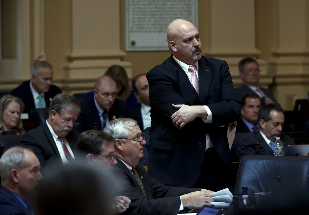 Del. Todd Gilbert, R-Woodstock, standing, listens to debate during the floor session of the Virginia House of Delegates at the state Capitol in Richmond on Tuesday.  Gilbert has been named the next majority leader of the lower chamber of the General Assembly. Bob Brown/Richmond Times-Dispatch via AP