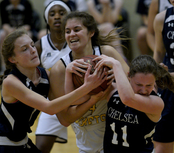 Randolph-Macon Academy's Lily Ruch gets tied up with Chelsea Academy's Agnes Wingate, left, and Elizabeth Solomon, right, during first quarter action Thursday evening in Front Royal.   Rich Cooley/Daily