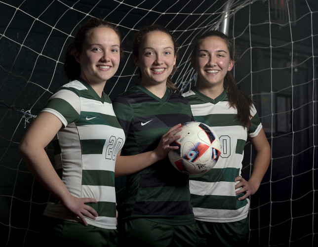 Shenandoah Valley Christian Academy's soccer sisters Rebekah Max, 16, left, and her twin sister, Sarah, center, and their older sister Hannah, 18, will help lead their soccer team this season. The girls are from Round Hill. Rich Cooley/Daily