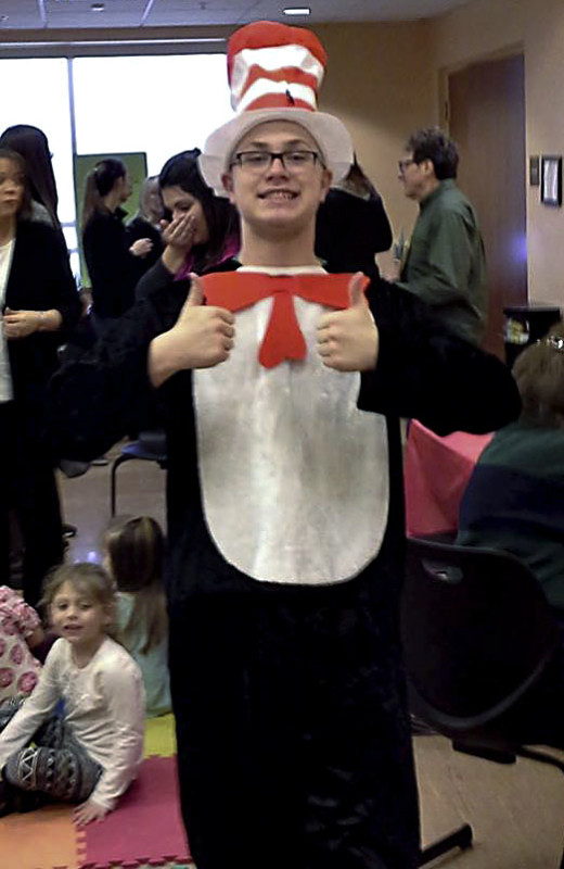 Samuels Library teen volunteer Ethan Henard appears as the Cat in the Hat on March 2 at the library's celebration of Dr. Seuss' birthday. Members of the Kiwanis Club of Front Royal, along with Key Club members Mary Ann Fryfogle and Bridgette Murphy, helped by serving breakfast and reading to the children during two family story times. The library also celebrated the success of over 250 children and teens who participated in the library's Winter Reading Club. Over 3,000 books were read. Courtesy photo