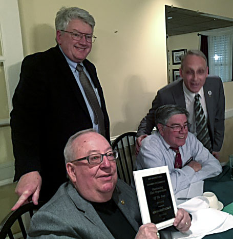 Edwin Newland displays the Outstanding Civic Organization plaque presented to the Rotary Club of New Market by the New Market Area Chamber of Commerce. Looking on, from left, are Peter Hughes, Jim Weissenborn and Bruce Alger. Courtesy photo