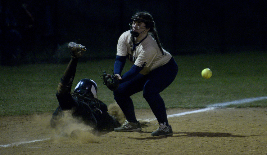 Skyline third baseman Valarie Martin misses a throw in a pick off attempt of William Monroe's Jessica Ford during fifth inning action Wednesday night in Front Royal. Ford was able to steal home plate on the play. Rich Cooley/Daily
