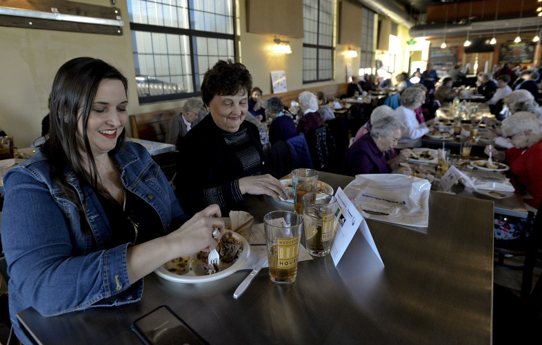 "Tracey Wygal, left, of Capon Bridge, West Virginia, and her mother, cancer survivor  Patty Wygal, right, eat 1752 Barbecue inside the Woodstock Brewhouse during the ""Surviving with Laughter"" event. The program featured a free dinner sponsored by 1752 BBQ and an evening of entertainment highlighted by actor Russell Rinker. Rich Cooley/Daily"