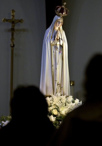 The International Pilgrim Virgin Statue of Our Lady of Fatima is on display Thursday inside St. John Bosco Catholic Church in Woodstock. The statute will be moved Thursday evening to St. John the Baptist Church on West Main Street in Front Royal, where there will be an overnight vigil.  Rich Cooley/Daily