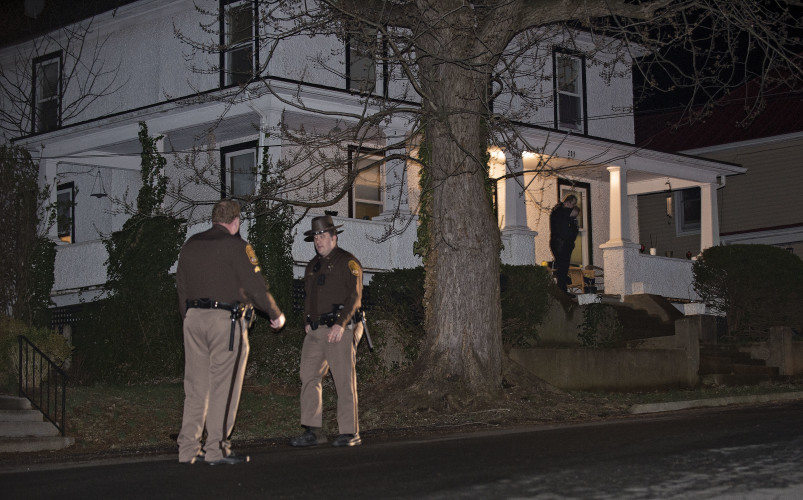 Warren County Sheriff deputies stand outside 208 Grand Ave. late Monday night to assist Front Royal Police with a shooting incident. Rich Cooley/Daily