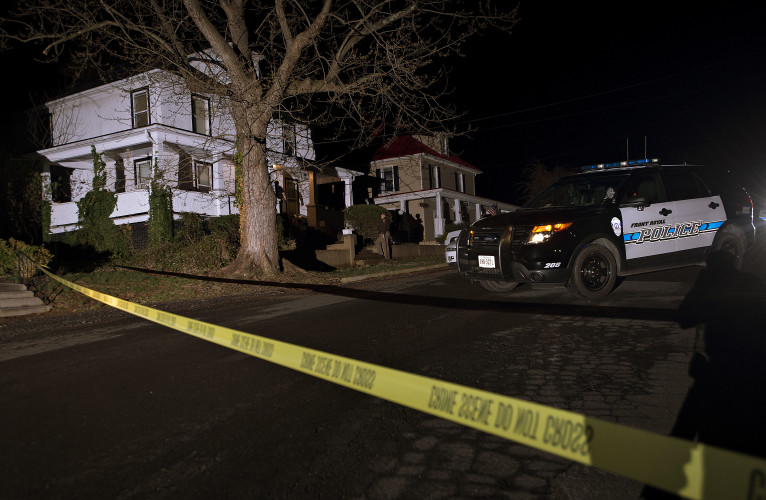 Police stand outside 208 Grand Ave. in Front Royal  Monday night after a reported shooting that left one person dead. Rich Cooley/Daily