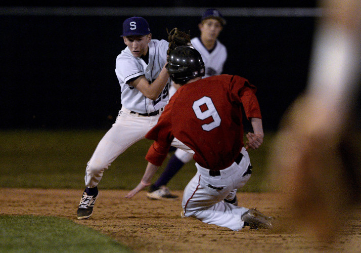 Stonewall's Christopher Estep breaks down into a slide into second base as Strasburg's Justin King prepares for the tag during fourth inning action Wednesday night at First Bank Park in Strasburg.  Estep was safe. Rich Cooley/Daily