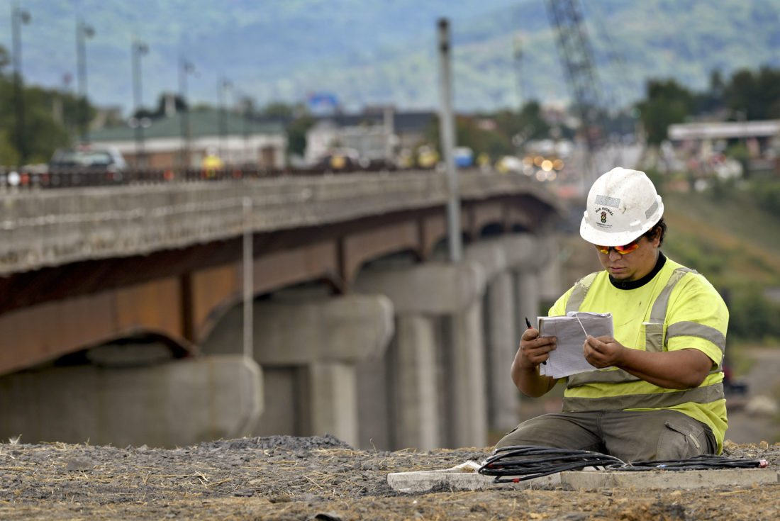 Vdot To Orient Public On New Intersection News Sports Jobs The Wiring Harness Construction Josue Nelson A Foreman For B Signal Company In Manassas Checks His Paperwork While Organizing Traffic Signals At South