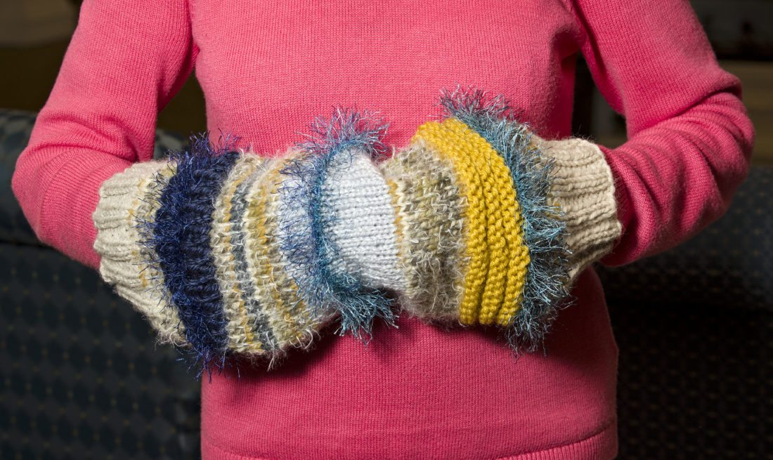 Twiddling with yarn: Knitters use craft to help residents with ...