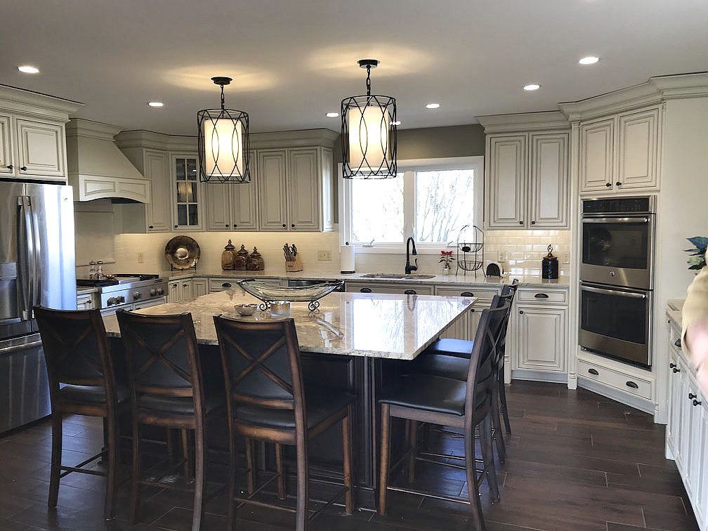 this carroll construction kitchen redesign focuses on shiny countertops updated flooring and a more family friendly atmosphere courtesy photo - The Kitchen Redesign