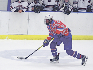 OBSERVERPhoto by Mary Ann Wiberg Fredonia's Bobby Polachek brings the puck up ice during his team's SUNYACmen's hockey game against the Potsdam Bears Friday night at the Steele Hall Ice Arena.