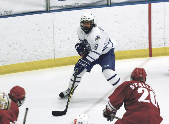 OBSERVER Photo by Justin Goetz Fredonia State's Oskar Gerhardson (9) looks for a shot on goal against Plattsburgh during Saturday's SUNYAC hockey matchup.