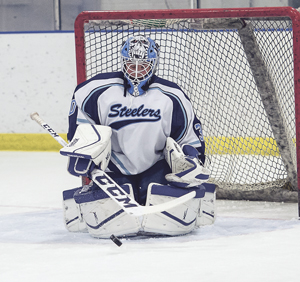 OBSERVERPhoto by Ron Szot Dunkirk-Fredonia's Nick Novelli makes a save during his team's WNYCHL game against the Buffalo Explorers, on Sunday at the Steele Hall Ice Arena. The Steelers won the game, 3-2.