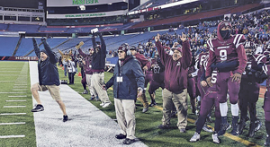 OBSERVERPhoto by Ron Szot Dunkirk players and coaches celebrate the Marauders' 50-48 overtime win over Batavia in the NYSPHSAAClass B Farwest Regional football game Saturday night at New Era Field, in Orchard Park. With the win, Dunkirk advanced to the NYSPHSAAsemifinals, where it will play Section IV's Chenango Forks at Cicero-North Syracuse High School on Saturday, Nov. 19 at 3 p.m.