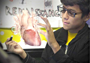 Photo from zspace.com. This photo from zspace.com shows a student being able to hold, rotate and dissect a human heart right in front of him, without actually touching it but still being able to see everything.