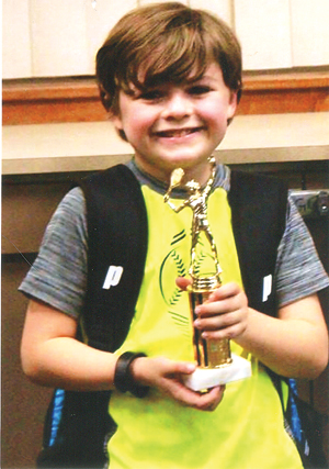 Submitted Photo JacksonSpangler, 9, of Fredonia, won the village Glen Orange Ball Tennis Tournament in Williamsville on Dec. 17. Spangler, a member of the Chautauqua Tennis Club, won the RedPool, defeating three other competitors in straight sets. Spangler then faced the winner of the Blue Pool in the tournament championship. There, he prevailed over Amelia Greenawalt, 10, of Lancaster, winning, 4-0, 4-1. Eight competitors were entered into the 10-and-under tournament.