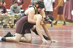 OBSERVERPhoto by Mary Ann Wiberg Fredonia's JackStorm takes control of Dunkirk's Brad Jones during Tuesday's action of the DunkirkDuals wrestling tournament. Action continues today, starting at 9 a.m.