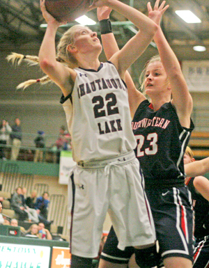 Photo by Cody Crandall Chautauqua Lake's Taylor Phelps (23) shoots over Southwestern's Isabel Bursch during Wednesday's championship game of the JCCShootout.