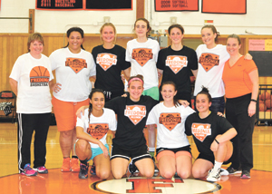 Submitted Photo The Fredonia HighSchool girls basketball alumni played at Fredonia High on Monday, Dec. 26. Pictured were the participants. They are, in front from left, Tiona Pittman, Morgan Genovese, Hannah Gilray and Rachael Smith. In back are Coach Carol Zirkle, Erykha Giordano, Madison Abram, Lauren Reyda, Julie Arnold, Grace Moore and Coach Susan Zirkle.