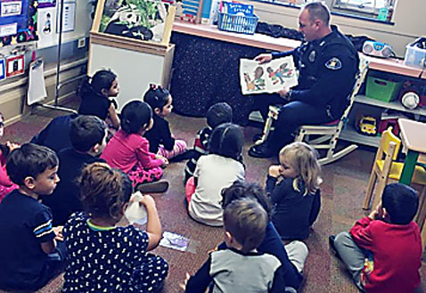 Submitted Photos Top: Officer Douglas Switzer reads to students. Above right: Pictured are the student ambassadors that escorted the police officers to the classrooms. Front row: Charlie Sutherland, Hans Lemiszko, Zaira Cooper, Jessica Maines, Jayden Kenner, Janaya Nazario and Mariusz Dobek. Back row: Officer Brian Dietzen, Sgt. Chris Witkowski, Officer Douglas Switzer, Officer Joseph Carruth, Sgt. Mark Gruber, Chief David Ortolano. This was the third Annual Dunkirk Police Department Reader Day at School 7. Above left: A thank you from a student.