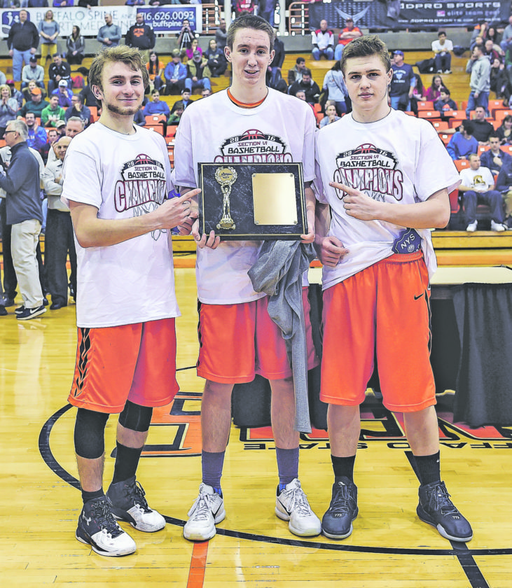 File Photo Pictured are Jarod Burmaster, Pat Moore and Eric Swoyer after the Fredonia Hillbillies won the Section VI Class B-2 boys basketball title over Buffalo Health Sciences, on Saturday, Feb. 27, at Buffalo State.
