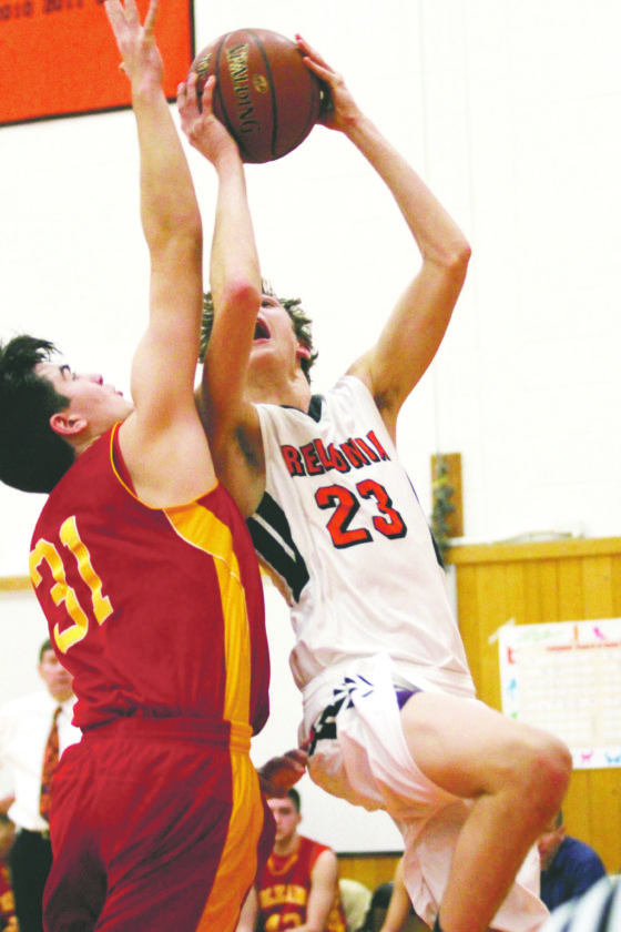 OBSERVER Photo by Lisa Monacelli Fredonia's Nick Ruckman (23) attempts a shot over Olean's Luke Rogers (31) during Tuesday's CCAA West 1 boys high school basketball game.