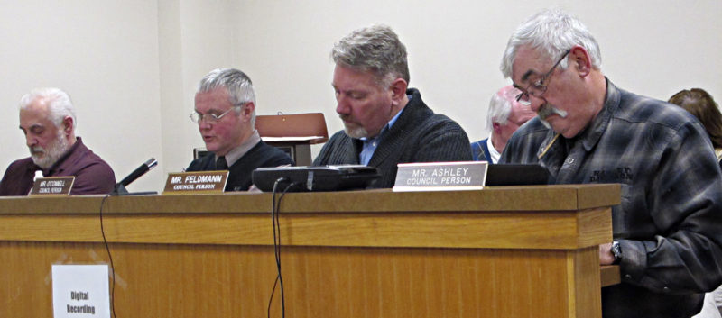 OBSERVER Photo by Rebecca Cuthbert Town of Hanover officials look over their notes as they prepare to set several public hearings during this week's town board meeting. From left: Councilman Louis Pelletter, Deputy Supervisor Kevin O'Connell, Councilman Bernard Feldmann Jr. and Councilman Wayne Ashley.