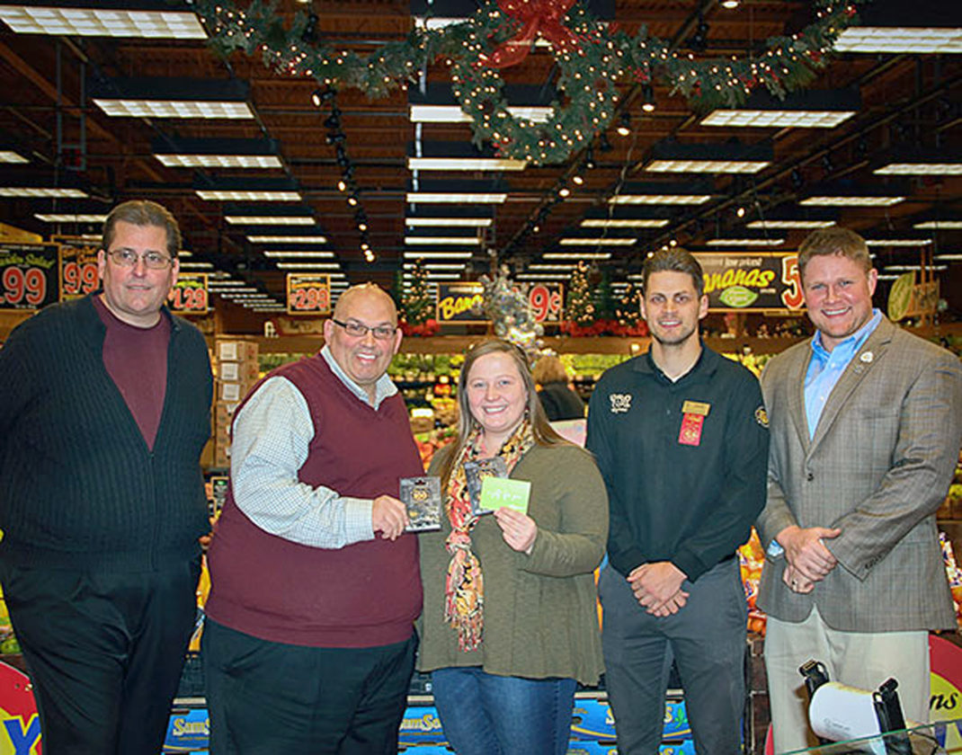 Submitted Photo Ashley Johnson (third from left), winner of Chautauqua Leadership Network's Season of Sharing fundraiser, Dave Thomas (far left), past president of CLN, and Justin Hanft (far right), president of CLN, along with Jake Yartz of Wegmans, presents $500 in Wegmans gift cards to Jeffrey Smith of St. Susan's Center (second from left) to provide items for its food pantry.