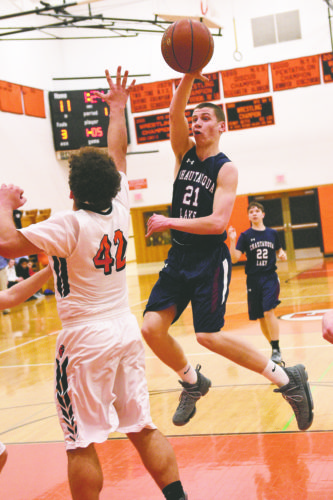 OBSERVERPhoto by Roger Coda Chautauqua Lake'sAaronSwan passes the ball during Tuesday's CCAAWest 1 boys high school basketball game against Fredonia.