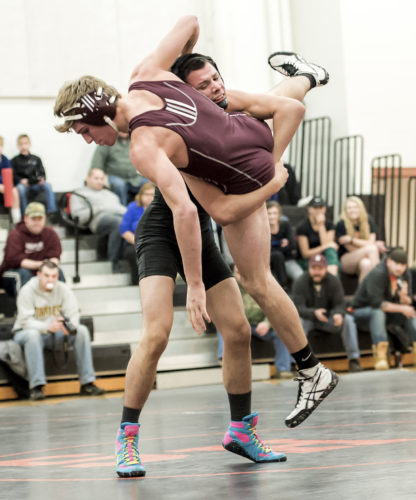 OBSERVER Photo by Ron Szot Fredonia's Hector Colom, back, takes down Dunkirk's Billy Seiders for two points during their 138-pound match of Thursday's CCAA high school wrestling meet.