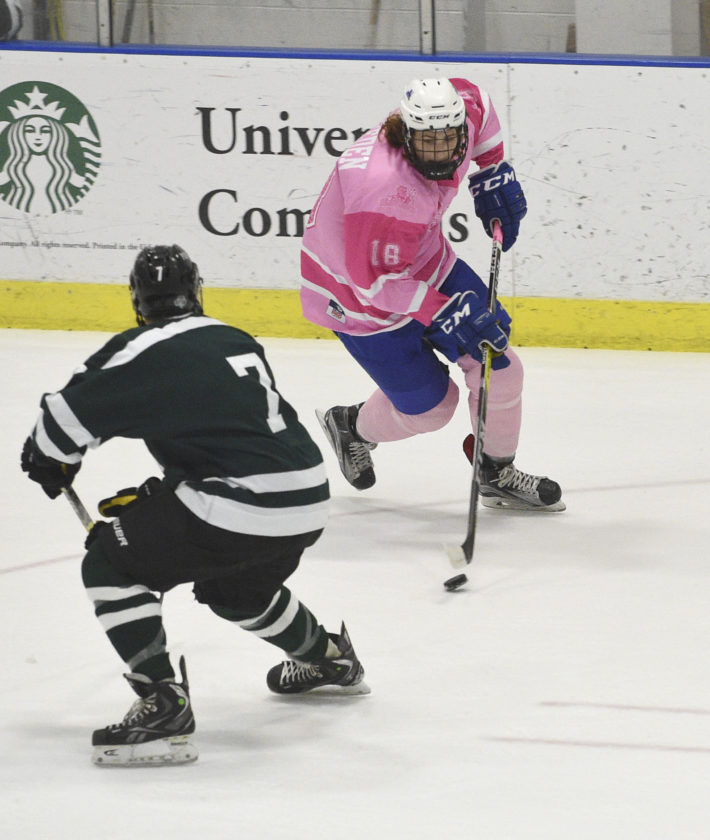 """Photo Courtesy of SUNYFredonia Athletics Fredonia's Gavin Nickerson (18) brings the puck up ice during the Blue Devils non-conference game against Post Saturday night at the Steele Hall Ice Arena. It was the annual """"Pink the Rink"""" game for Fredonia, as money was raised for cancer research."""