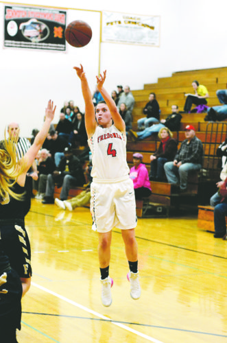 OBSERVERPhoto by Justin Goetz Fredonia's Hannah Cybart (4) goes over the 1,000-point mark on this 3-pointer with 3:16 left in the fourth quarter on Friday, during her team's CCAAWest 1 girls basketball game against Falconer at Fredonia High School.