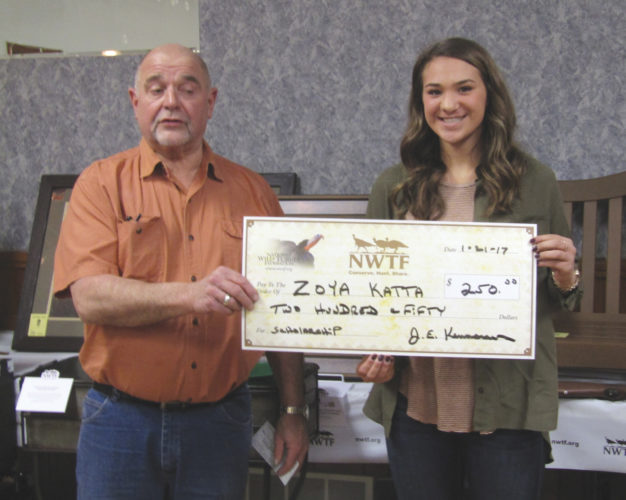 OBSERVER Photo by Gene Pauszek Pictured from left to right are Scott Dibble, president of the Lakeshore Longbeards, presenting a check for $250 to Zoya Katta, who won the  local chapter of the NWTF prize for her entry in the scholarship competition.