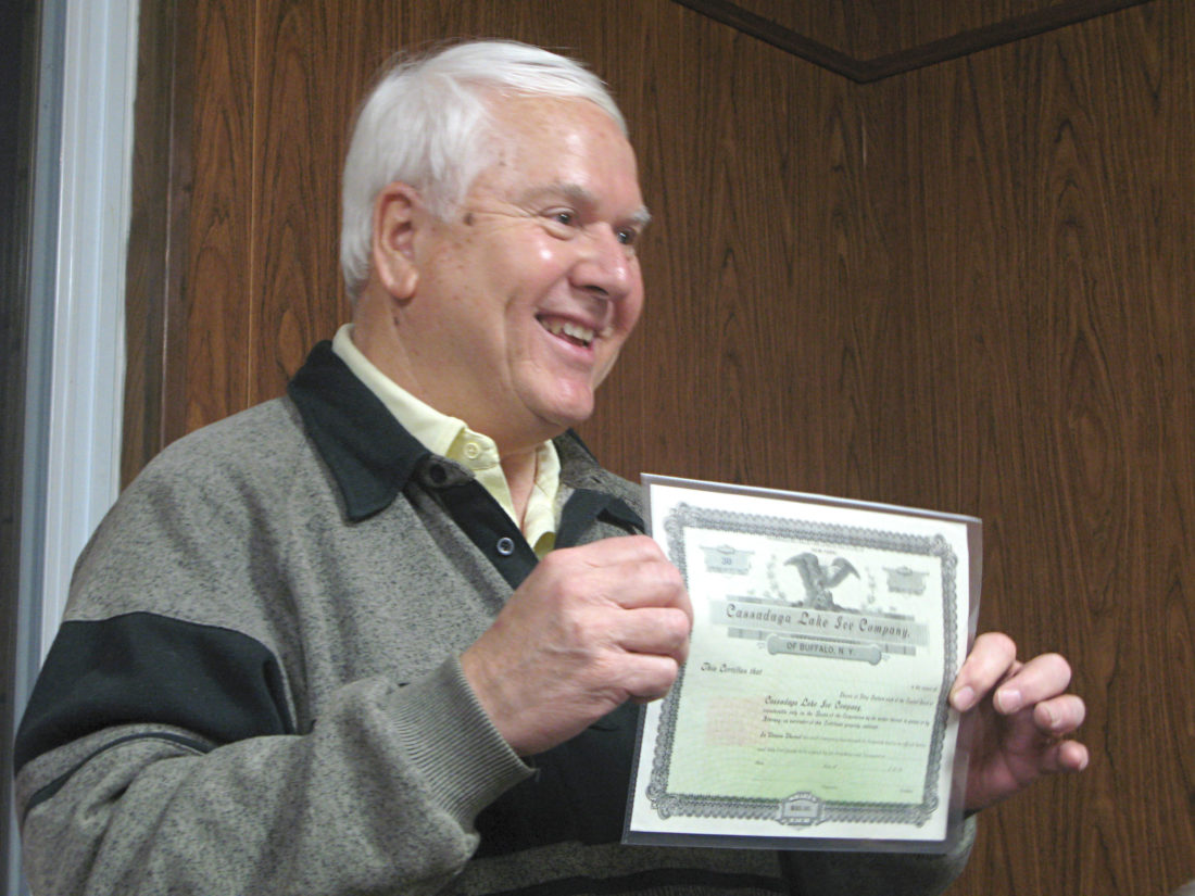 OBSERVER Photo by Amanda Dedie Cassadaga Village Historian John Sipos presents an unearthed certificate — never used — for 50 shares of the former Cassadaga Lake Ice Company.