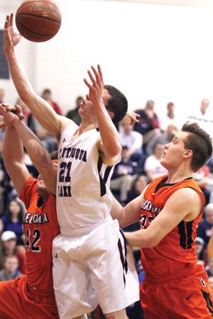 At right, Chautauqua Lake's Aaron Swan (21) pulls down a rebound.