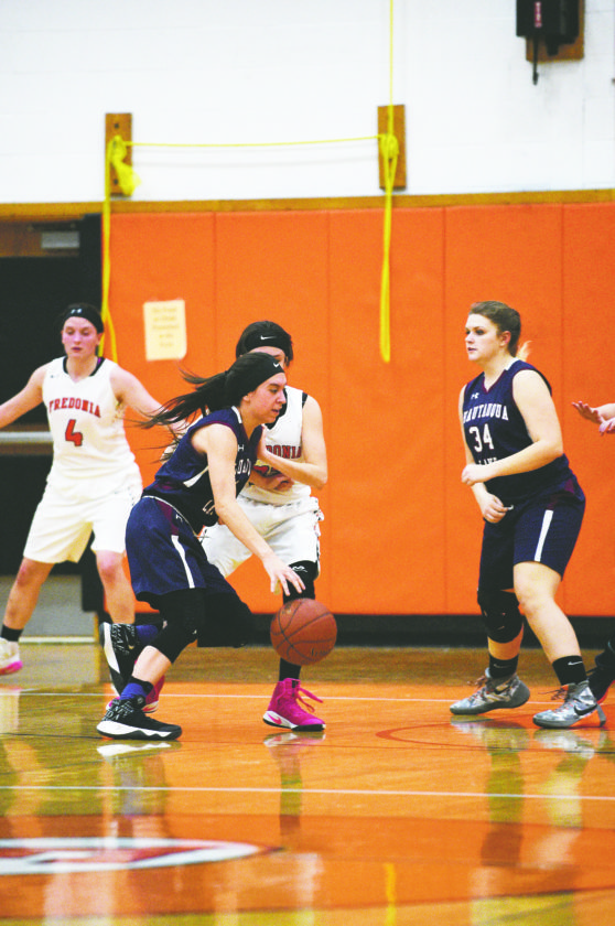 OBSERVER Photos by Roger Coda At left, Chautauqua Lake's Katelyn Fardink drives to the basket during Tuesday's CCAA West 1 girls high school basketball game. At left, Fredonia's Gracie Morrison (34) goes up for a layup ahead of Chautauqua Lake's Abigail Henry (10).