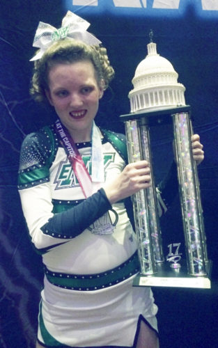 Submitted Photo Dunkirk resident Mallory Wojcinski holding the trophy she and her Team Extraordinary teammates won in competition in Washington, D.C.