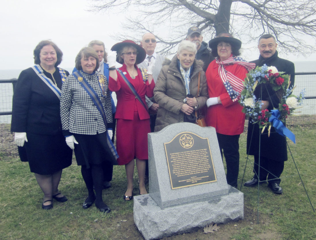OBSERVER Photos by Diane R. Chodan Above: Members of the National Society United States Daughters of 1812, Dunkirk Lighthouse board members, and Dunkirk Mayor Willie Rosas gathered at the memorial after the dedication. Left to right, front: National Treasurer and NYC Chapter Registrar Ann Farley, 4th Vice President National and State Historian Mary Raye Casper, State President Beverly Sterling-Affinati, Charlotte Lasher, State Chaplain pro tem Elfreda Stangland, and Dunkirk Mayor Rosas. Back row: State Chairman Doreen Cesari, Dunkirk Lighthouse Events Coordinator David Briska, and Dunkirk Lighthouse President Michael Vinciguerra.